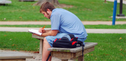 Student studying outside.