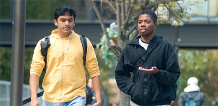 Two students walking on campus.